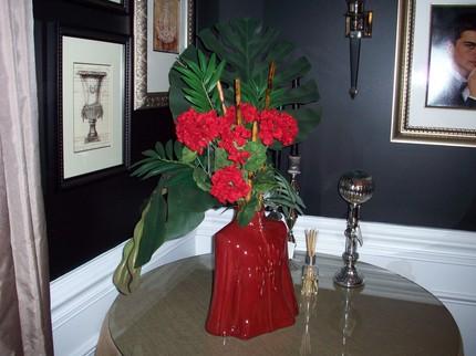 Compressed red floral arrangement